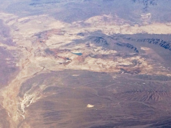 Overflight of Ash Meadows NWR. The blue water feature in the center is Crystal Reservoir.